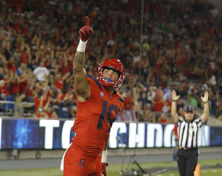Arizona wide receiver Shawn Poindexter celebrates after scoring a touchdown in the first half during an NCAA college football game against Oregon, Saturday, Oct. 27, 2018, in Tucson. (Rick Scuteri/AP)