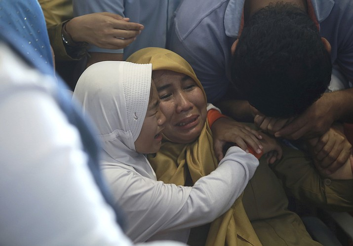 Relatives of passengers comfort each other as they wait for news on a Lion Air plane that crashed off Java Island at Depati Amir Airport in Pangkal Pinang, Indonesia Monday, Oct. 29, 2018. Indonesia disaster agency says that the Lion Air Boeing 737-800 plane crashed into sea shortly after it left Indonesia's capital Monday morning. (Hadi Sutrisno/AP)