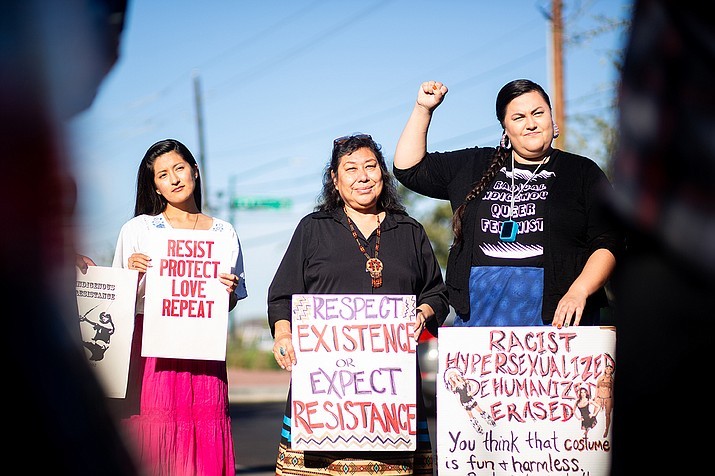 From left: Savanna Castorena, Rosetta Walker and Taté Walker protest Halloween costumes sold by the Phoenix company Yandy.com. Castorena is Pascua Yaqui, Rosetta Walker is Sicangu Lakota and Taté Walker is Miniconjou Lakota. (Photos by Anya Magnuson/Cronkite New