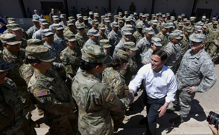 Arizona's Republican Gov. Doug Ducey, front right, meets with Arizona National Guard soldiers prior to their deployment to the Mexico border at the Papago Park Military Reservation on Monday, April 9, 2018, in Phoenix. (Ross D. Franklin/AP, File)