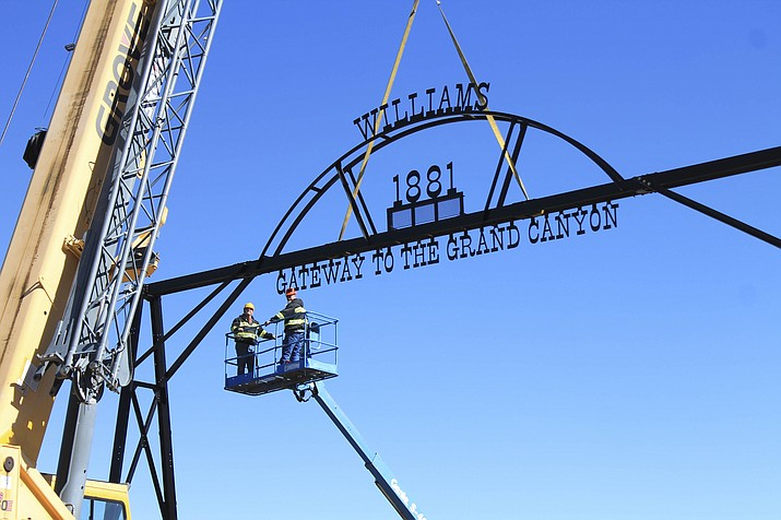 The city of Williams partnered with APS and the Arizona State Railroad Museum Foundation to complete the final arch in the Williams Gateway Arch project which began in 2009. (Loretta Yerian and Wendy Howell/WGCN)