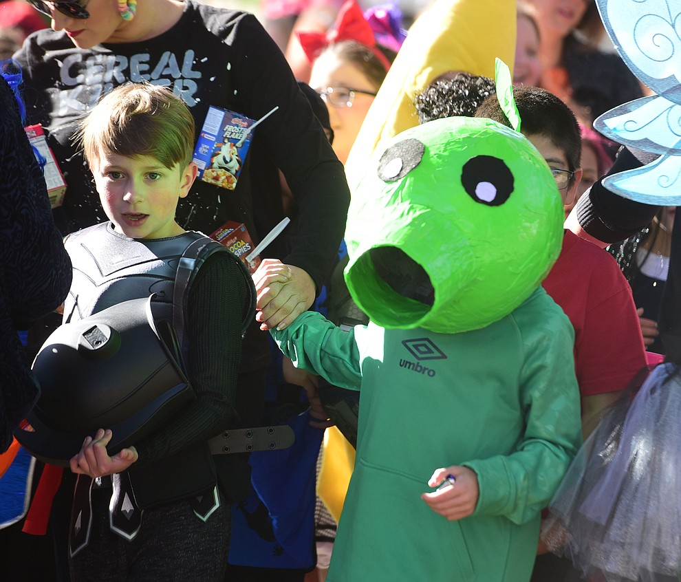 Students from Lincoln Elementary School in Prescott hold their annual Halloween parade around the Courthouse Plaza in Prescott Wednesday, Oct. 31, 2018.  (Les Stukenberg/Courier).