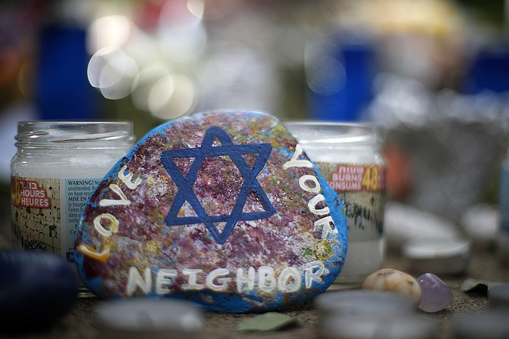 This is a painted rock found Wednesday, Oct. 31, 2018, part of a makeshift memorial outside the Tree of Life Synagogue in the Squirrel Hill neighborhood of Pittsburgh, to the 11 people killed during worship services Saturday Oct. 27, 2018. (Gene J. Puskar/AP)
