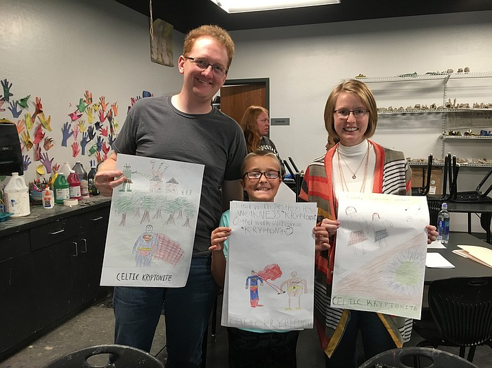Big Brother Mike and Big Sister Michelle Schoenfeld and their Little Brother Timothy show their movie posters from the workshop. (Courtesy)
