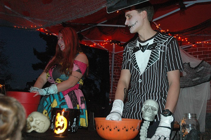 Amanda Dodds and Jonathan Pierce dressed as Sally and Jack Skellington from 'The Nightmare Before Christmas' at the 21st annual Trick or Treating at Memory Park event Halloween night Wednesday, Oct. 31, 2018, in Chino Valley. (Jason Wheeler/Courier)
