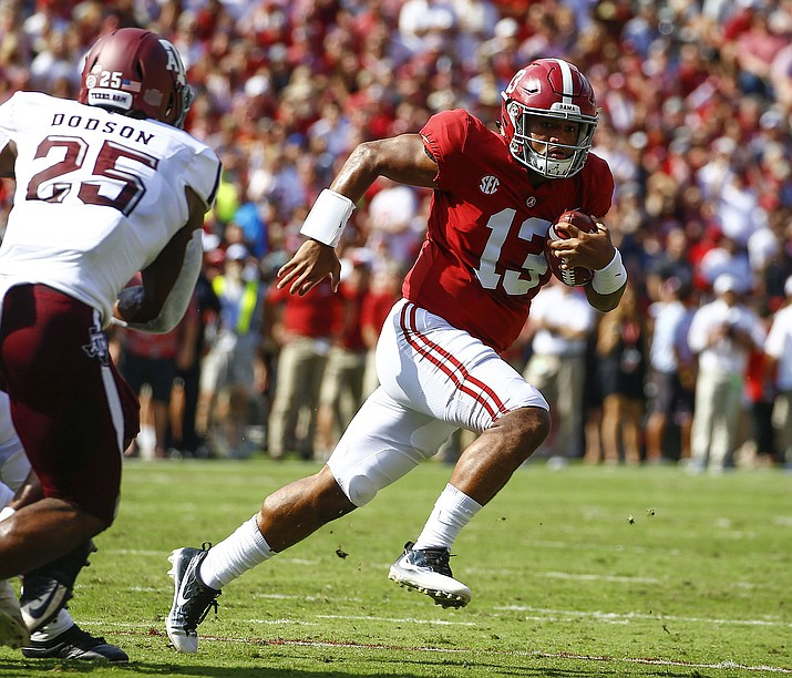 Alabama quarterback Tua Tagovailoa scrambles for a first down against Texas A&M during the first half of their game Sept. 22, 2018, in Tuscaloosa, Ala. (Butch Dill/AP, File)