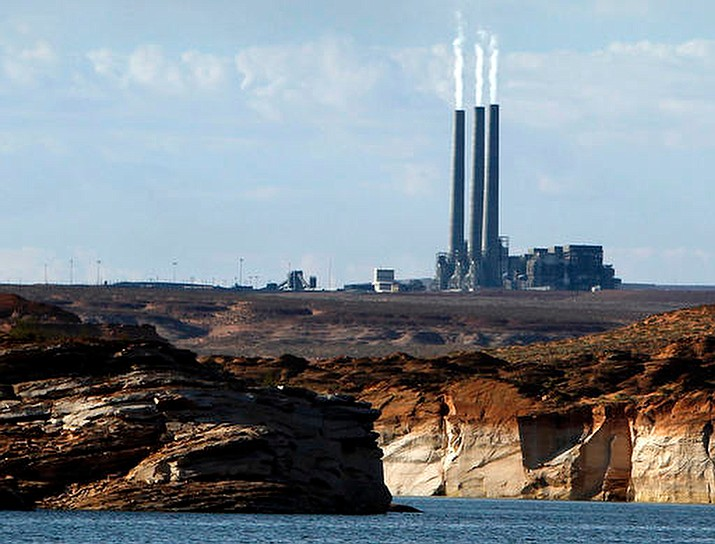 Smoke rises from the stacks of the main plant facility at the Navajo Generating Station, as seen from Lake Powell in Page on Sept. 4, 2011. (Ross D. Franklin/AP, File)