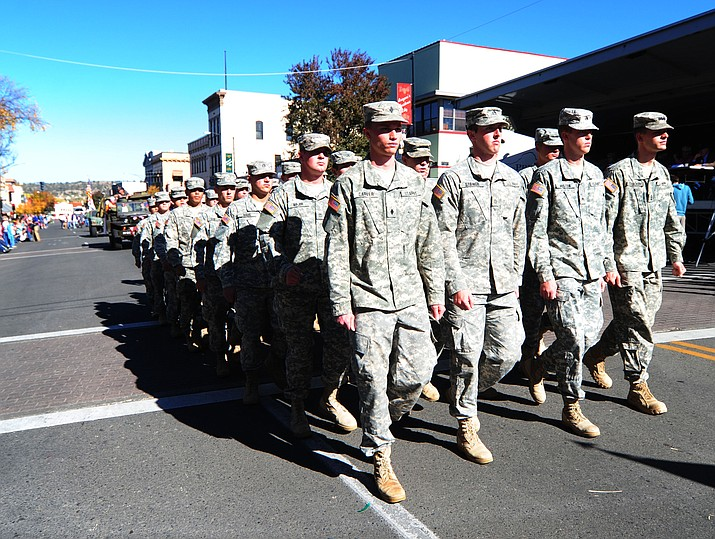 In this 2016 file photo, crowds line the streets as the Veterans Day Parade winds through the streets of downtown Prescott. The 2018 parade is set for 11 a.m., Saturday, Nov. 10 and will feature five grand marshals – all veterans from the Prescott area who served in various military roles and world conflicts. (Les Stukenberg/Courier, file)