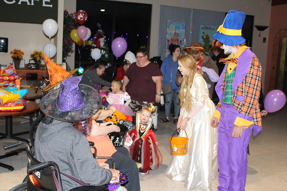 Residents at The Gardens Rehab Center hand out candy on Halloween night.