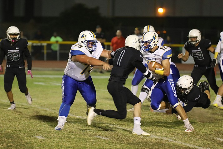 Prescott quarterback Austin Clark (12) looks for a hole in the defense against No. 6-ranked Greenway in the first round of the 4A state playoffs Friday, Nov. 2, 2018, in Phoenix. (Jim Clark/Courtesy)