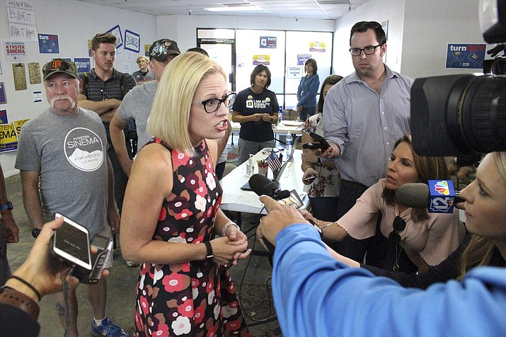 Democratic U.S. Senate candidate Kyrsten Sinema talks to the media after rallying volunteers at a get-out-the-vote phone bank in Phoenix, Ariz., Thursday, Nov. 1, 2018. Sinema and Republican Martha McSally are taking different approaches to the campaign, with Sinema focusing on retail politics and McSally rallying with high profile Republicans like Donald Trump Jr. (Bob Christie/AP)
