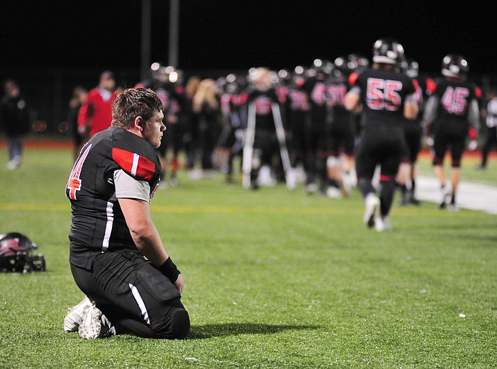 Bradshaw Mountain's Cameron Harris kneels on the sidelines as the Bears hosted No. 9-ranked Mingus in the first round of the 4A state playoffs Friday, Nov. 2, 2018, in Prescott Valley. (Les Stukenberg/Courier)