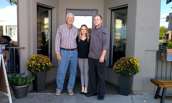 Ryan and Brittany Peters, owners of Farm Provisions in Prescott, stand with SCORE mentor Dick Milon outside their restaurant. (SCORE/Courtesy)
