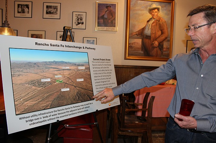 In this file photo, Bill Lenhart, managing member of Sunbelt Development and Realty Partners, points to a layout for the Rancho Santa Fe Parkway and Interchange, which is critical to his proposed 700-acre mixed-use development that would start with 1.1 million square feet of industrial warehouse. (Daily Miner file photo)