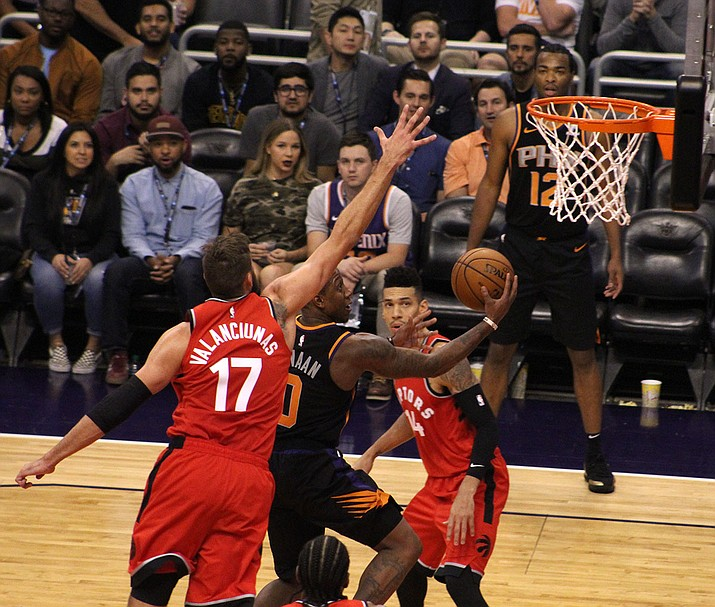 Isaiah Canaan drives to the basket Friday night against the Raptors. Canaan led the Suns with 19 points in a 107-98 loss at Talking Stick Resort Arena. (Photo by Beau Bearden/Daily Miner)