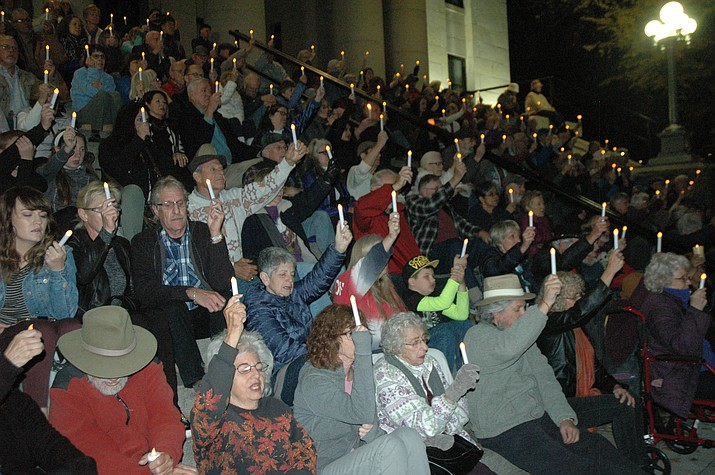 The City of Prescott and The Jewish Community Foundation of Greater Prescott hosted a candlelight vigil Saturday, Nov. 3, at Yavapai County Courthouse plaza, honoring the victims of the Tree of Life Synagogue shooting in Pittsburgh on Oct. 27. Yavapai County Attorney Sheila Polk said she found hope in the people at the vigil, urging everyone to find ways to take action and never forget. Similarly, David Hess, president of the Jewish Community Foundation of Greater Prescott, encouraged the attendees to repay evil with compassion and good.(Jason Wheeler/Courier)