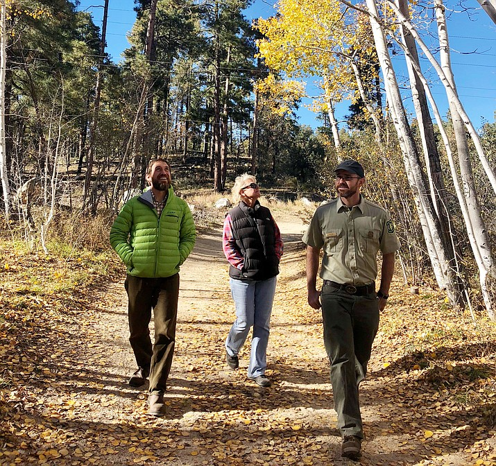 National Forest Foundation Associate Spencer Plumb, left, Prescott National Forest Timber Resource Specialist Lori Johnson, center, and Prescott National Forest Forester Ben Roe, right, walk through the small stand of aspen trees along Copper Basin Road this week. (Cindy Barks/Courier)
