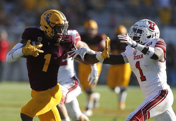 Arizona State wide receiver N'Keal Harry (1) fends off Utah defensive back Jaylon Johnson in the second half Saturday, Nov. 3, 2018, in Tempe. (Rick Scuteri/AP)