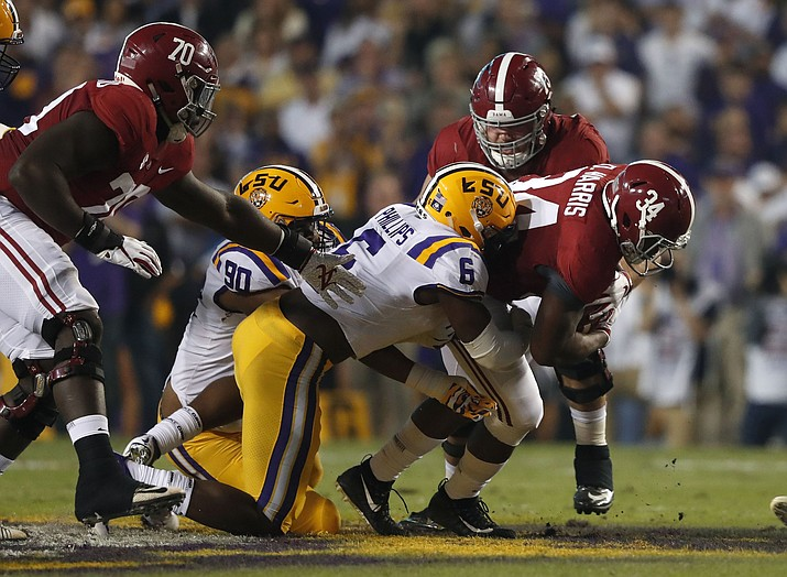 Alabama running back Damien Harris (34) carries against LSU linebacker Jacob Phillips (6) and defensive lineman Stephon Wynn Jr. (90) in the first half of an NCAA college football game in Baton Rouge, La., Saturday, Nov. 3, 2018. (Gerald Herbert/AP)