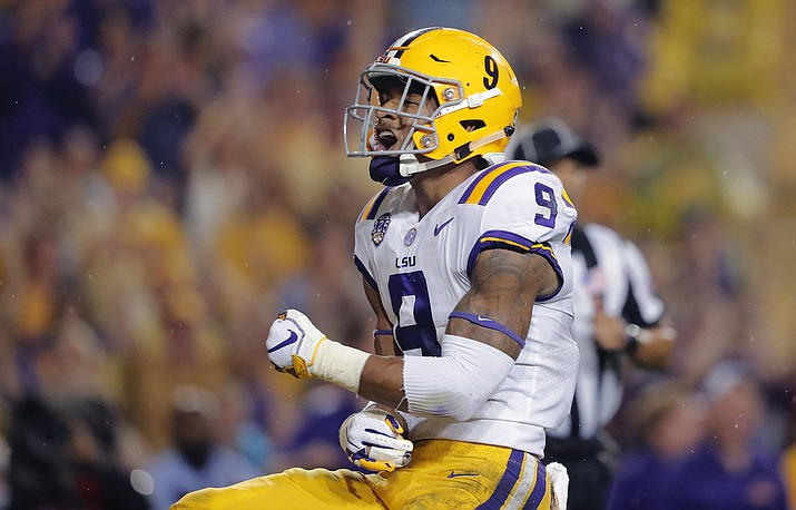 In this Sept. 29, 2018, file photo, LSU safety Grant Delpit (9) celebrates his sack of Mississippi quarterback Jordan Ta'amu during the first half in Baton Rouge, La. (Gerald Herbert/AP, file)