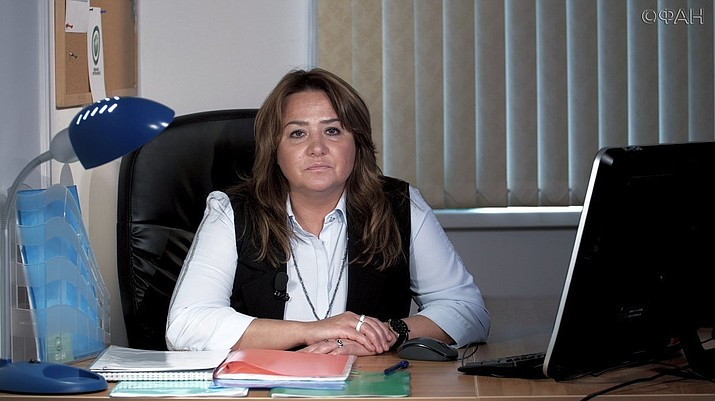 """In this handout photo taken from the Federal News Agency website on Monday, Oct. 22, 2018, Elena Khusyaynova, an accountant poses for a photo. The first person charged with foreign interference in the 2018 midterms, Elena Khusyaynova, said """"my heart filled with pride"""" at the accusation. (Federal News Agency via AP)"""