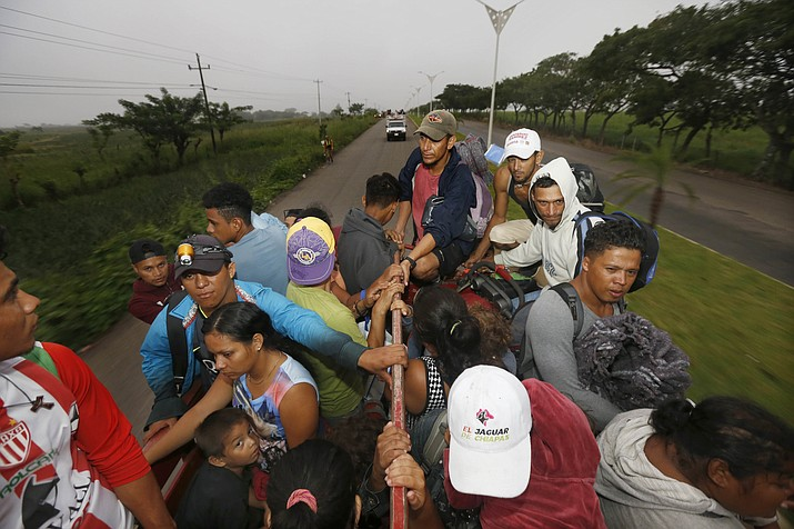 Central American migrants begin their morning trek as part of a thousands-strong caravan hoping to reach the U.S. border, as they move away from Isla, Veracruz state, Mexico, Sunday, Nov. 4, 2018. (Marco Ugarte/AP)