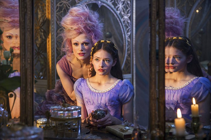 "This image released by Disney shows Keira Knightley, left, and Mackenzie Foy in a scene from ""The Nutcracker and the Four Realms."" (Laurie Sparham/Disney via AP)"