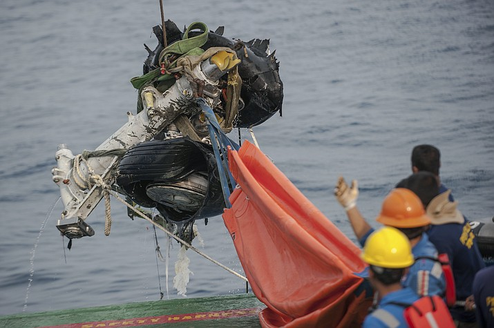 Rescuers use crane to retrieve part of the landing gears of the crashed Lion Air jet from the sea floor in the waters of Tanjung Karawang, Indonesia, Sunday, Nov. 4, 2018. Investigators succeeded in retrieving hours of data from the aircraft's flight recorder as Indonesian authorities on Sunday extended the search at sea for victims and debris. (Fauzy Chaniago/AP)
