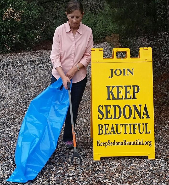 Courtesy Photo by Keep Sedona Beautiful.  Carla Williams, KSB Litter Lifter, with new sign.