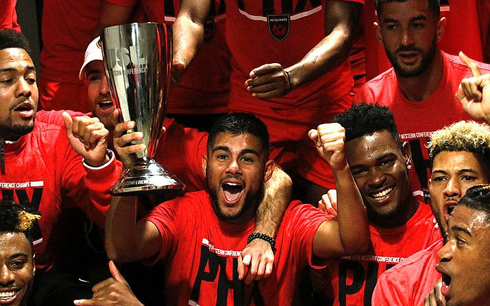 Phoenix rising midfielder Collin Fernandez holds the USL Western Conference trophy. The Rising will play for the USL Cup. (Photo by Ricardo Ávila, Cronkite News)