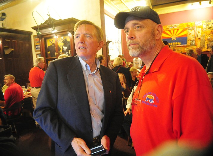 Arizona Congressman Paul Gosar, left, watches early returns with Yavapai County Republican Party Chairperson Mark Sensmeier during a Republican election night party at the Palace Restaurant & Saloon Tuesday, Nov. 6, 2018 in Prescott.  (Les Stukenberg/Courier)