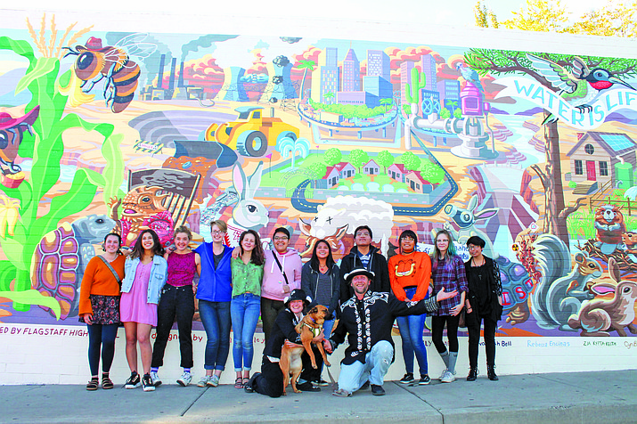 A group of Flagstaff High School art students pose with Mural Mice Maggie Dewar and R.E. Wall at the Oct. 24 unveiling of the water justice mural they designed during a retreat last month at Kane Ranch. (Erin Ford/WGCN)