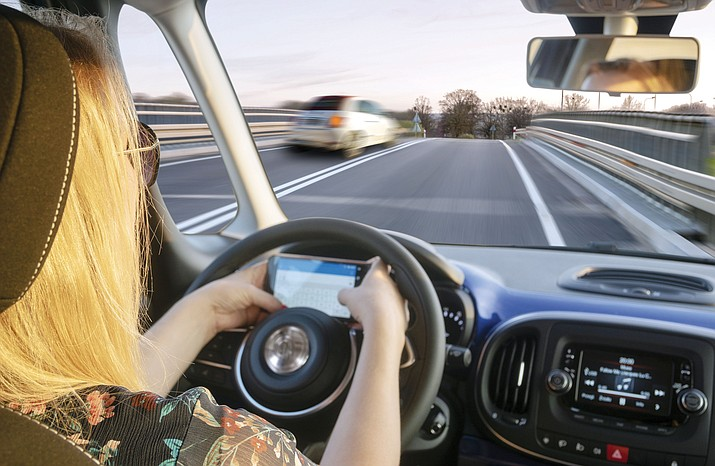 Town officials are looking to ban distracted driving. (Tribune stock image)