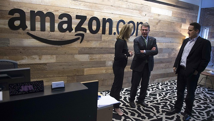 In this March 3, 2016 photo, former Defense Secretary Ash Cart, right, tours Amazon headquarters in Seattle. Amazon is now reportedly looking to build offices in two cities instead of one. The areas include Long Island City in New York and Crystal City in Virginia. (Photo by Navy Petty Officer 1st Class Tim D. Godbee)