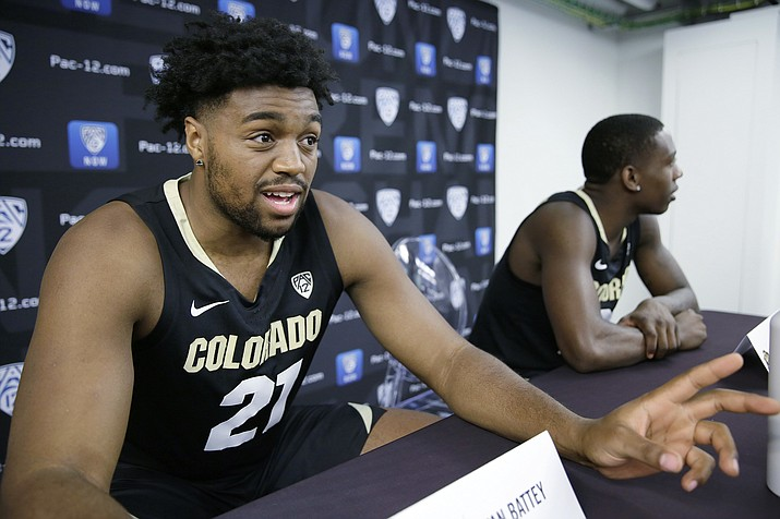 In this Thursday, Oct. 11, 2018, file photo. Colorado forward Evan Battey, left, and guard McKinley Wright IV take questions during the Pac-12 NCAA college basketball media day in San Francisco. Battey, a redshirt freshman from California, is preparing to take the court for the team, a debut delayed by almost a year after he suffered a stroke and two seizures last December during a pickup game with friends. (Eric Risber/AP, File)
