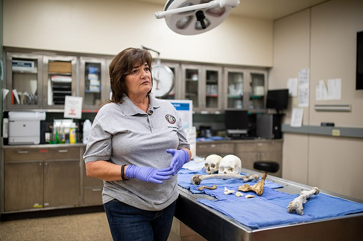 Laura Fulginiti, a forensic anthropologist, says her job is to develop a biological profile including the sex of the individual, the age they died, the height of the person, and then anything unique or individual about them that will help us identify a missing person. (Photo by Celisse Jones/Cronkite News)