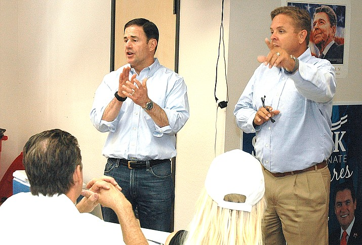 Gov. Doug Ducey and state Republican Party Chairman Jonathan Lines give a pep talk Tuesday morning to party volunteers. (Capitol Media Services photo by Howard Fischer)