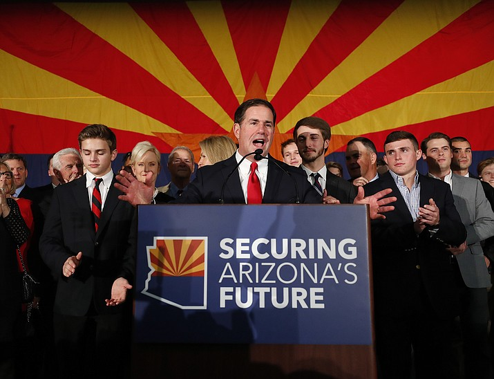 Arizona Gov. Doug Ducey, R, speaks to supporters, Tuesday, Nov. 6, 2018, at an election night party in Scottsdale. Incumbent Ducey defeated democratic challenger David Garcia for his second term. (Matt York/AP)