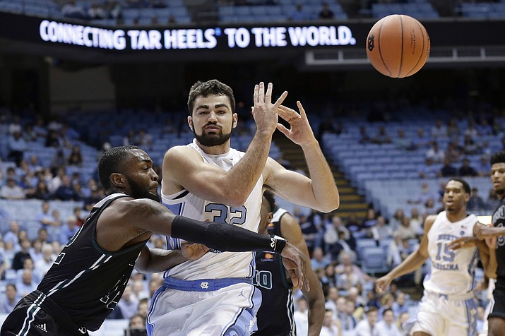 North Carolina's Luke Maye (32) loses the ball while Mount Olive's Cameron Robinson defends during the first half of a college basketball exhibition game in Chapel Hill, N.C., Friday, Nov. 2, 2018. (Gerry Broome/AP)