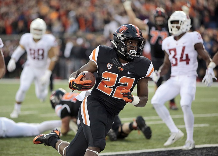 In this Oct. 6, 2018, file photo, Oregon State running back Jermar Jefferson (22) scores a touchdown during an NCAA college football in Corvallis, Ore. There's a pair of running backs in the state of Oregon that are making a case for Freshman of the Year honors: The Beavers' Jermar Jefferson and the Ducks' CJ Verdell. (Timothy J. Gonzalez/AP, File)