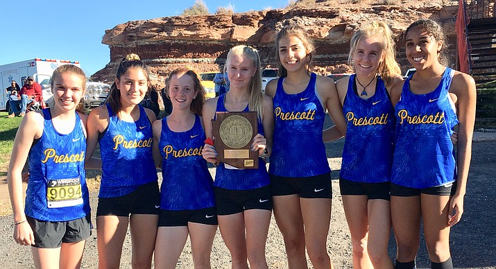 The Prescott girls cross-country team poses for a photo after claiming the sectional title this past weekend. (Courtesy)