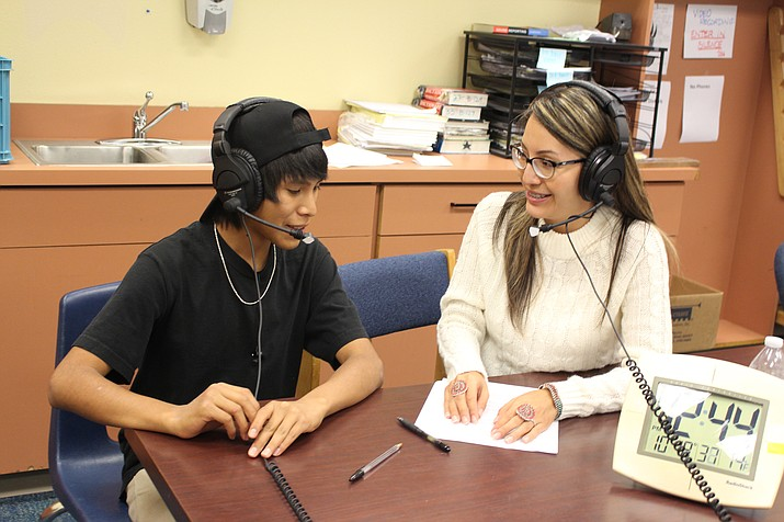 New Director of Federal Projects Latoya Largo at Hopi Jr/Sr High School is interviewed by Hopi High student Luis Miranda. (Stan Bindell/NHO)