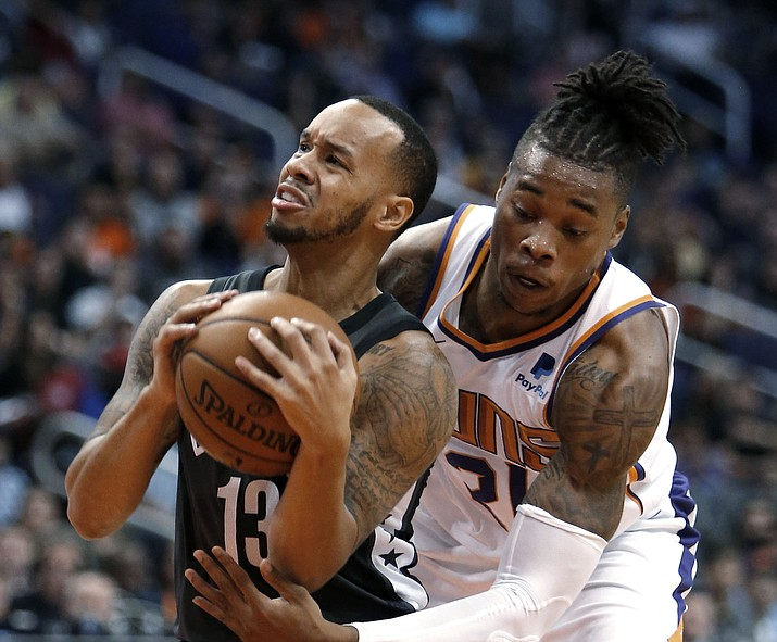 Brooklyn Nets guard Shabazz Napier (13) gets pressured by Phoenix Suns forward Richaun Holmes during the first half of an NBA basketball game Tuesday, Nov. 6, 2018, in Phoenix. (Rick Scuteri/AP)