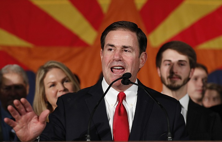Arizona Gov. Doug Ducey speaks to supporters, Nov. 6, at an election night party in Scottsdale. Incumbent Ducey defeated democratic challenger David Garcia for his second term. (AP Photo/Matt York)