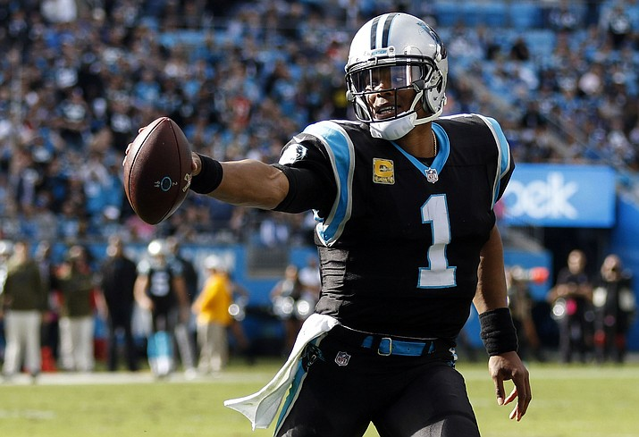 In this Sunday, Nov. 4, 2018, file photo, Carolina Panthers quarterback Cam Newton runs with the football against the Tampa Bay Buccaneers in the second half of an NFL football game in Charlotte, N.C. The Panthers face the Steelers on Thursday in Pittsburgh. (Nell Redmond/AP, File)