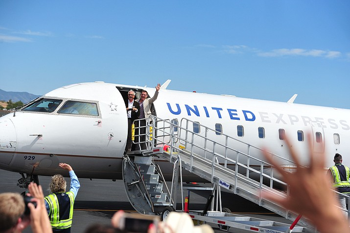 Prescott City Councilman Steve Sischka and Mayor Greg Mengarelli wave after arriving as United Express officially opened for business at the Prescott Regional Airport on Aug. 29, 2018. (Les Stukenberg/Courier, file)