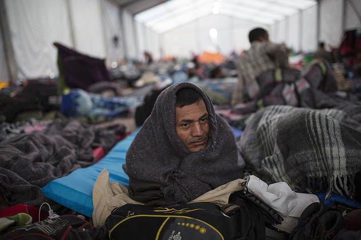 Alcides Padilla, from Honduras, wakes up at the Jesus Martinez stadium in Mexico City, Wednesday, Nov. 7, 2018. Central American migrants on Wednesday continued to straggle in for a rest stop at a Mexico City stadium, where about 4,500 continue to weigh offers to stay in Mexico against the desire of many to reach the U.S. border. (Rodrigo Abd/AP)