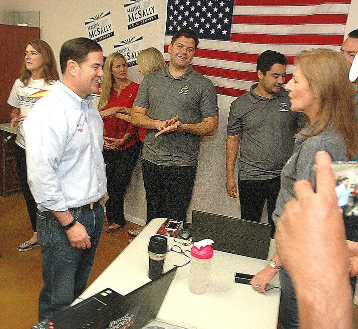 Gov. Doug Ducey chats with Republican volunteers Tuesday morning in Ahwatukee. (Capitol Media Services photo by Howard Fischer)