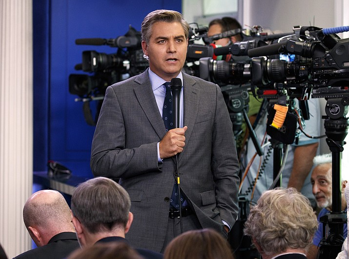 In this Aug. 2, 2018 file photo, CNN correspondent Jim Acosta does a stand up before the daily press briefing at the White House in Washington. The White House on Wednesday suspended the press pass of CNN correspondent Jim Acosta after he and President Donald Trump had a heated confrontation during a news conference. (AP Photo/Evan Vucci, File)