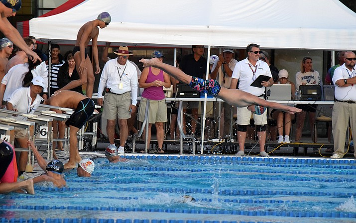 Mingus junior Andrew Peterson dives into a pool during a relay at the state meet. The boys 200 Free relay finished second a set a school record and Peterson finished 11th and 15th individually. VVN/James Kelley